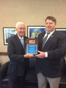 Former Lt. Governor Jim Gardner (L) accepts the VLC Flag Day Award from VLC Exec Director John Turner.